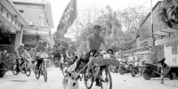 村民骑行3万公里,沿途送助学款13万 - 广东大洋网